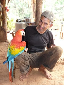 A local Brazalian farmer with a Scarlet Macaw. Credit: JM Ochoa-Quintero